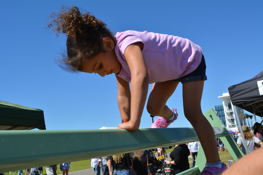 Three-year-old Asha Mayorga-Rao completes the Sarasota County Sheriff's Office SWAT team's obstacle course.