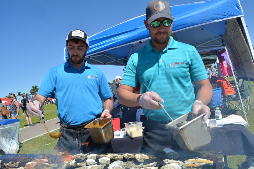 Sean Ferguson and Jerry Stennett grill up oysters for Half Shell Seafood House.