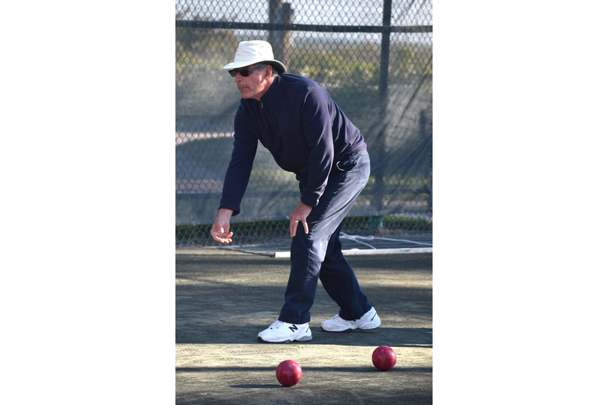 Gerald Daly watches as his ball rolls toward the pallino.