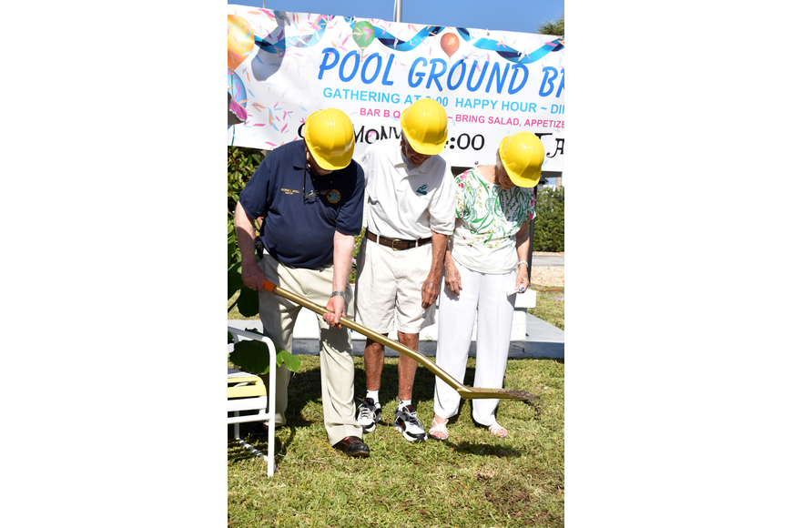 Mayor George Spoll scoops a patch of grass and dirt to mark the official groundbreaking.