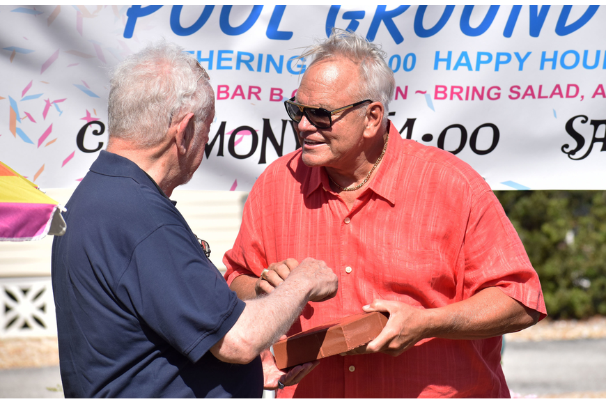 Mayor George Spoll is recognized with a memorial brick by Jim Boltz.