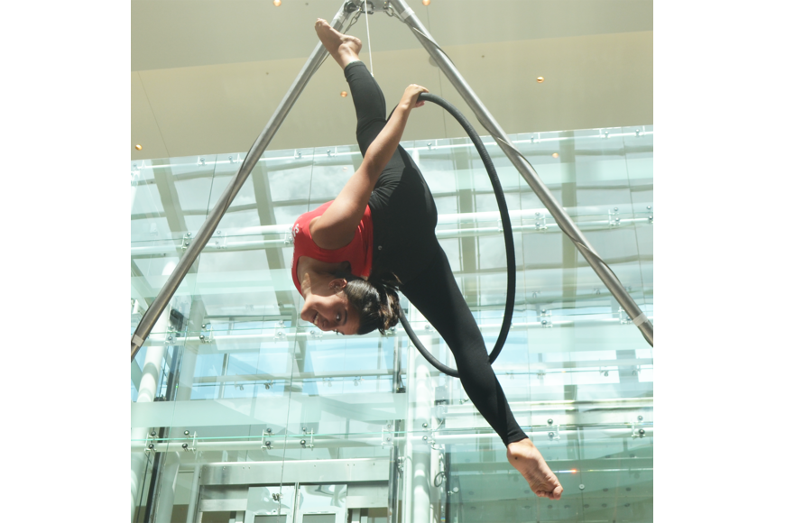 The Sailor Circus Academy's Emma Clarke, 12, has an almost five minute routine of spins and twists high above the ground in her hoop.