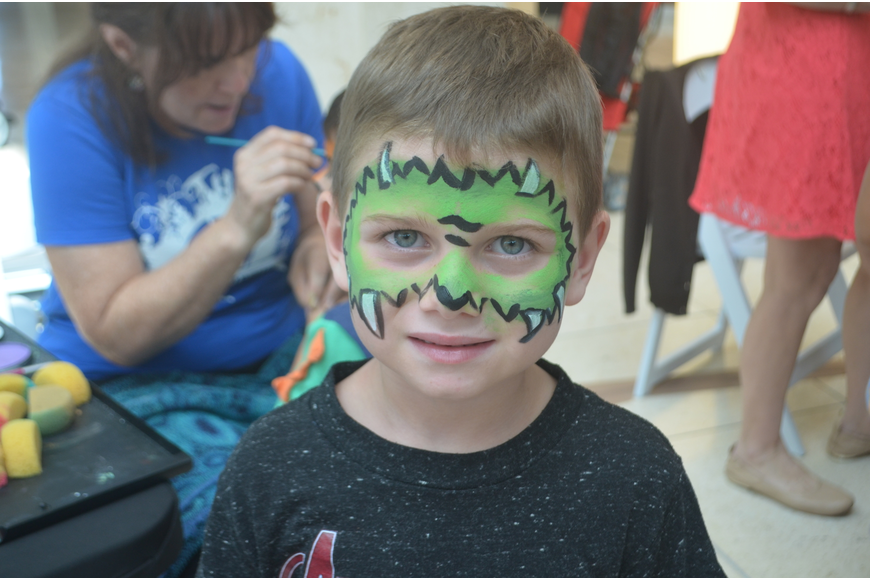 Parrish resident Jackson Stoles, 5, says he got a dragon painted on his face because it