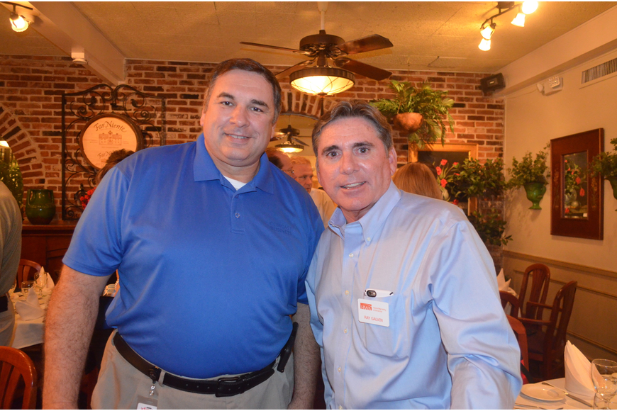 Adam Samblis, of Comcast Business, and Ray Galvin, of Home Warranty of America