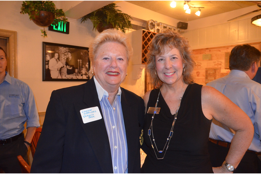Lynette Warnars, of Insignia Bank, and Cathleen Acosta, of Stewart Tile