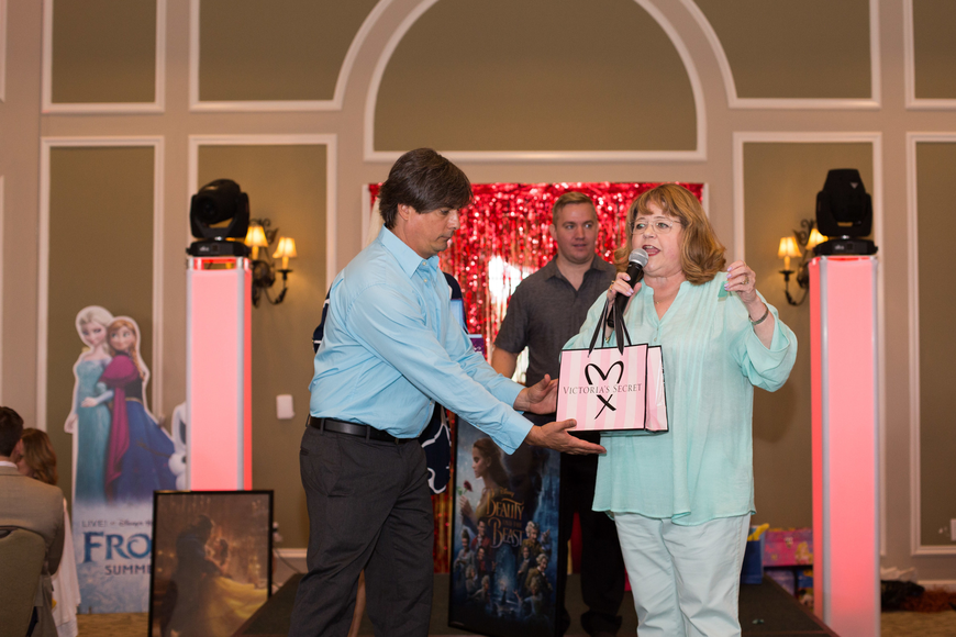 Brian Dattilo helps Patrika Darbo give out the raffle items.