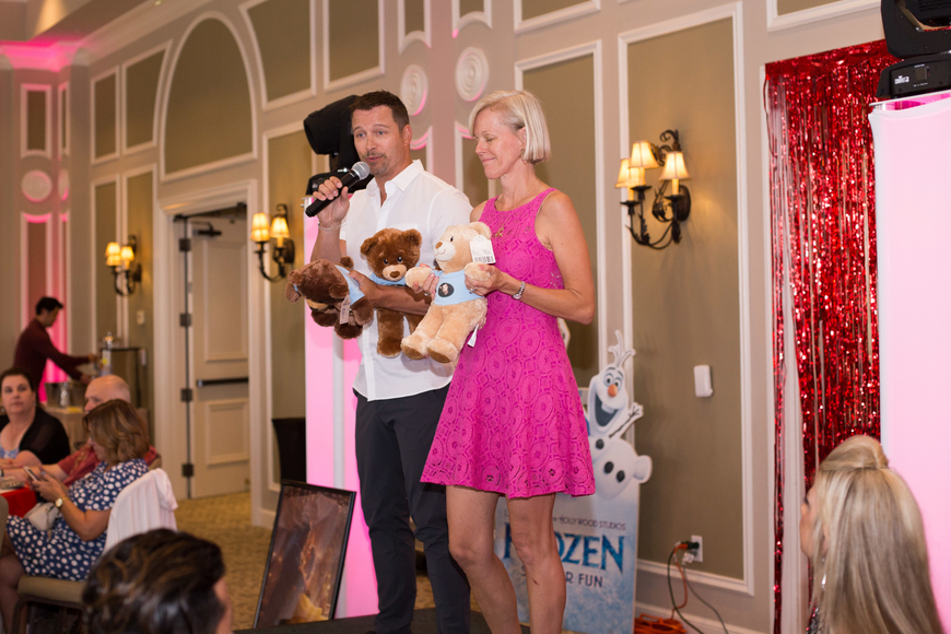 Eric Martsolf and Kari Schmitz sell Bears Who Care on stage.