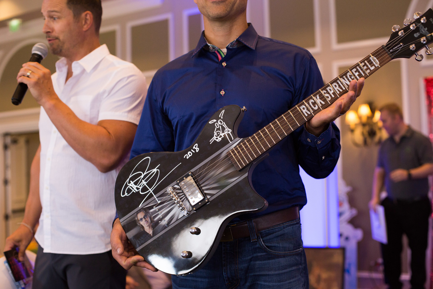 A Rick Springfield-signed guitar was purchased in the live auction for $800.