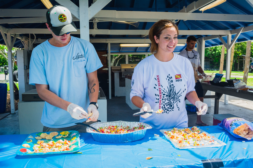 Cody Cole and Lisa Burton serve up lionfish ceviche.