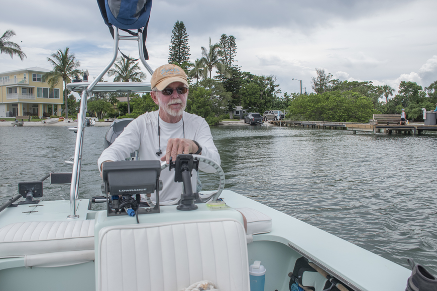 Rusty Chinnis navigates his boat from the northern bayside shore of Longboat Key to Sister Keys