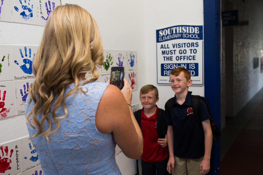 Tiffany Hamilton takes a photo of her boys, Cooper and Kennedy, at Southside Elementary.