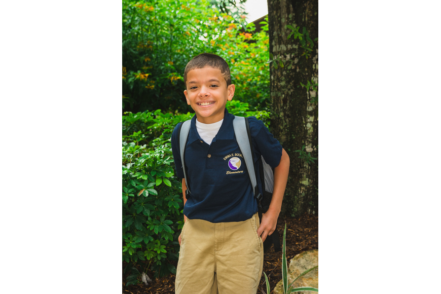 Emma E. Booker Elementary students A.J. Colon rocks his new uniform on the first day of school.