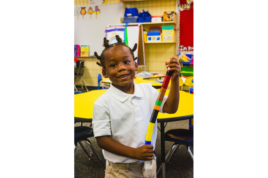 Emma E. Booker Elementary kindergartner Tarrance Timmons plays with building blocks before class starts.