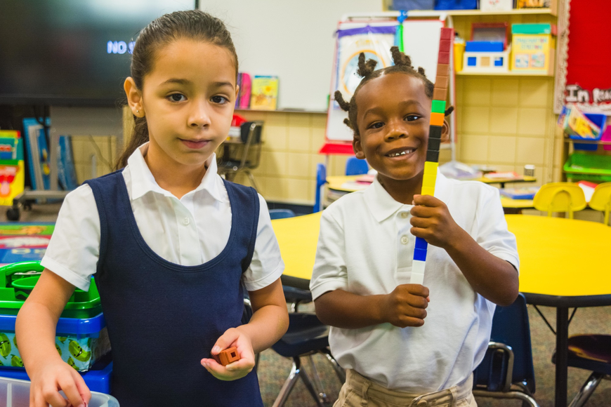 Emma E. Booker Elementary kindergartners Liz Kamila Molina and Torrance Timmons get to know  each other as classmates.