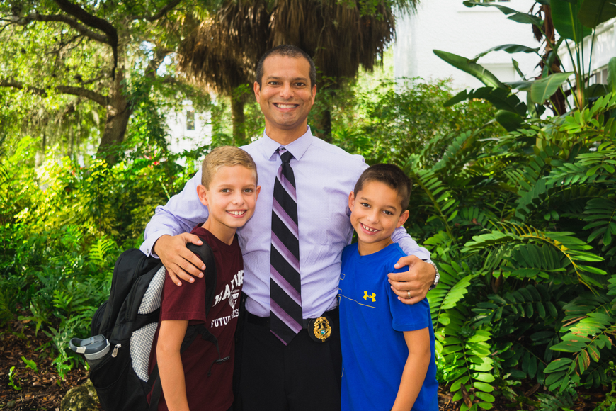Gerardo Carillo drops his sons, Logan and Dylan, off at Bay Haven School of Basics Plus.