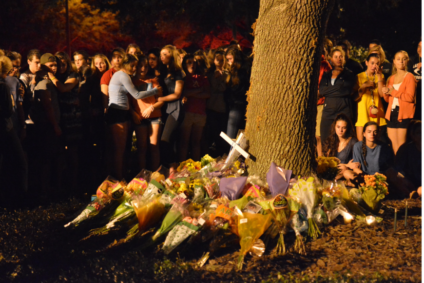 Hundreds of students gathered for a candlelight vigil at the accident site starting at 8 p.m. Sunday.