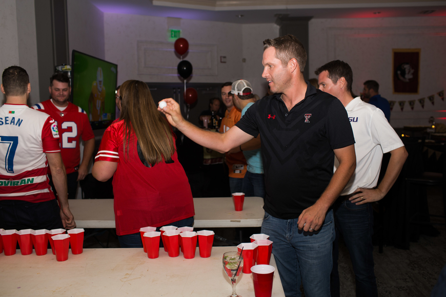 Eric Bobb shoots for the last cup in his beer pong game.
