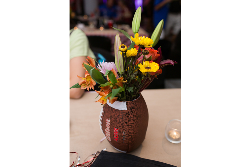 The centerpieces were made out of footballs and flowers.
