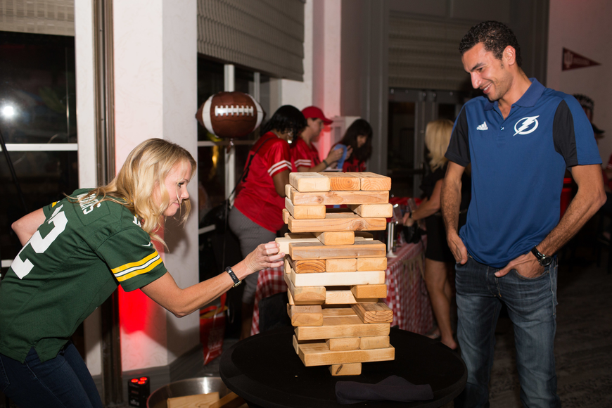 Autumn McConnell and Yamen Elsaid play jumbo sized Jenga.
