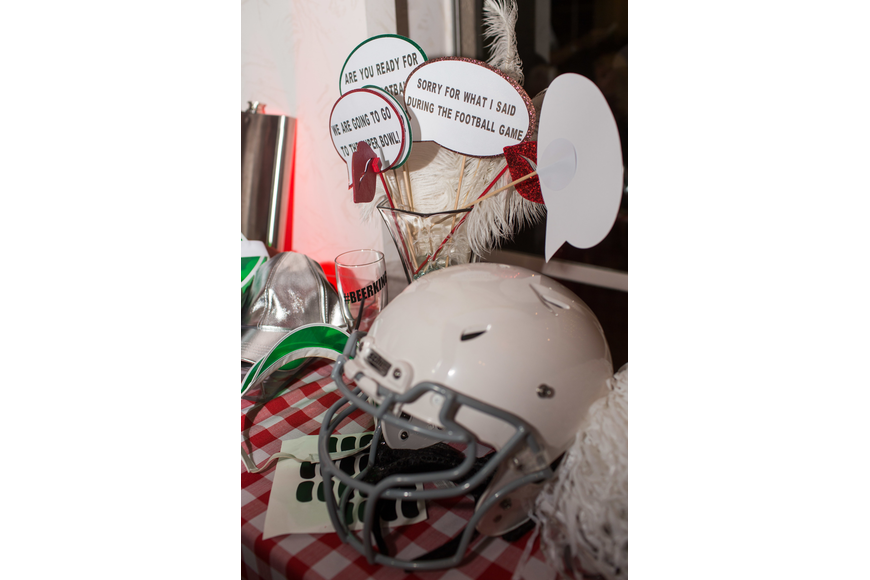Football themed props were available to use for the photo booth.