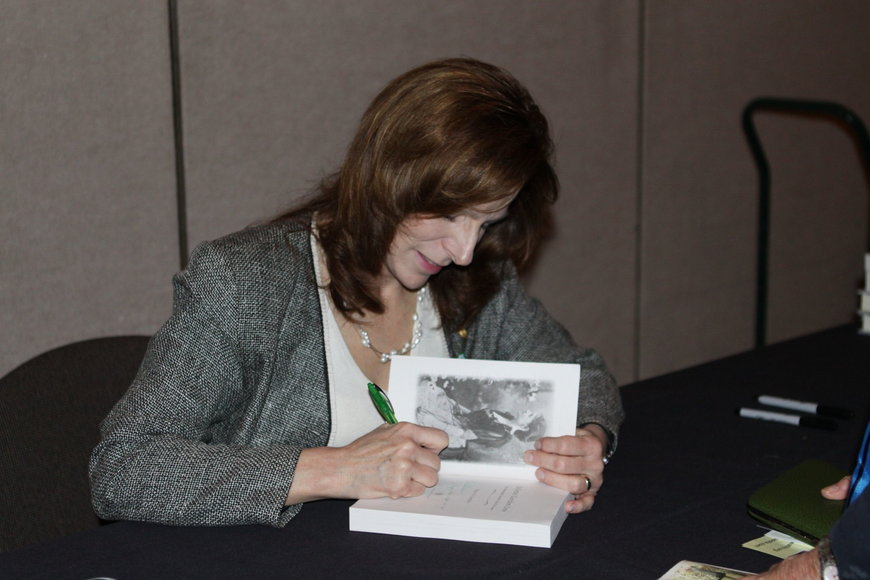Stacy Cordrey signing her book.