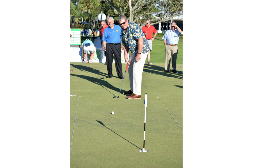 Longboat Key Police Chief Pete Cumming watches the ball roll toward the hole after his putt.