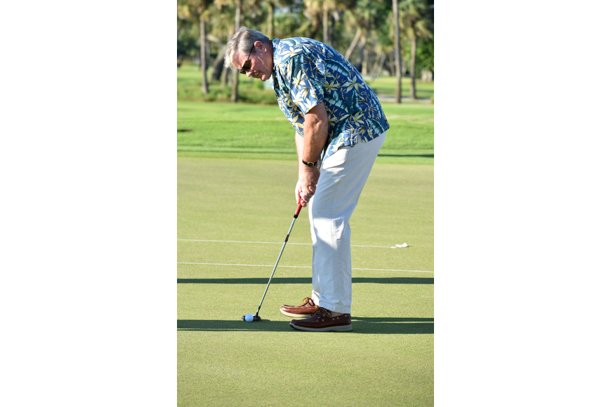 Longboat Key Police Chief Pete Cumming gets ready to putt.