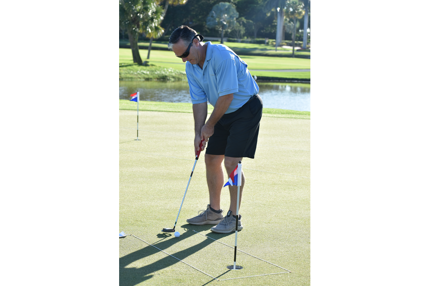 Longboat Key Fire Rescue Chief Paul Dezzi takes his turn at the putting challenge.