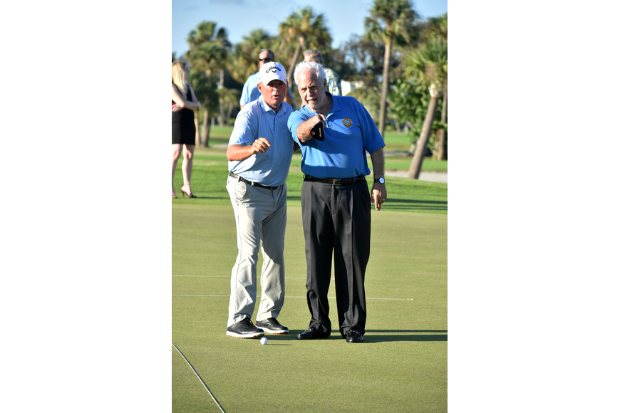 Longboat Key Club Director of Golf Terry O'Hara gives Commissioner Irwin Pastor advice on the final hole.