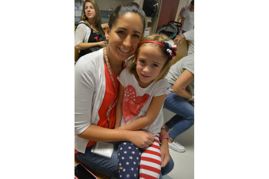 Tara Elementary School third-grade teacher Katelyn Fulghum got to snuggle with her 5-year-old daughter Ella, a kindergartner, during the show.