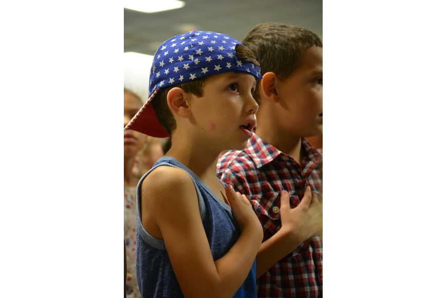 Kindergarten student Jaxon Turasz wears a patriotic hat for the celebration. He said the