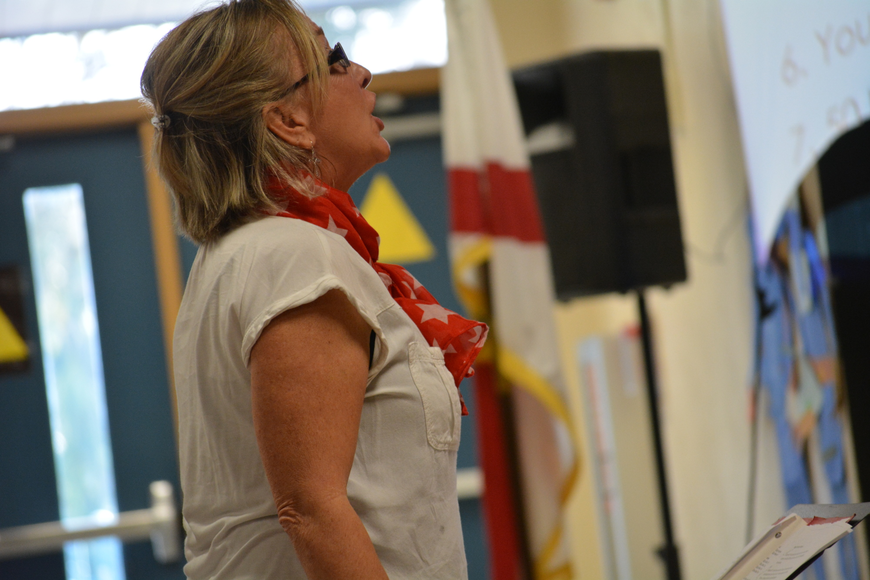 Music teacher Barbara Siffermann loves teaching traditional patriotic songs to the children.