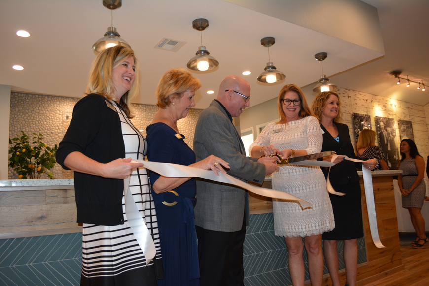 The ribbon is cut for the reopening of the Lakewood Ranch Information Center on University. Enjoying the moment were Heather Kasten, Vanessa Baugh, Jimmy Stewart, Angie Kaleskas, and Jahna Leinhauser.