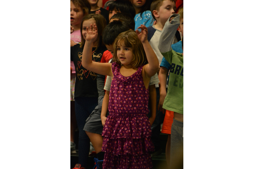 Kindergartener Isabella Madrid sings about how cold Sneezy is.