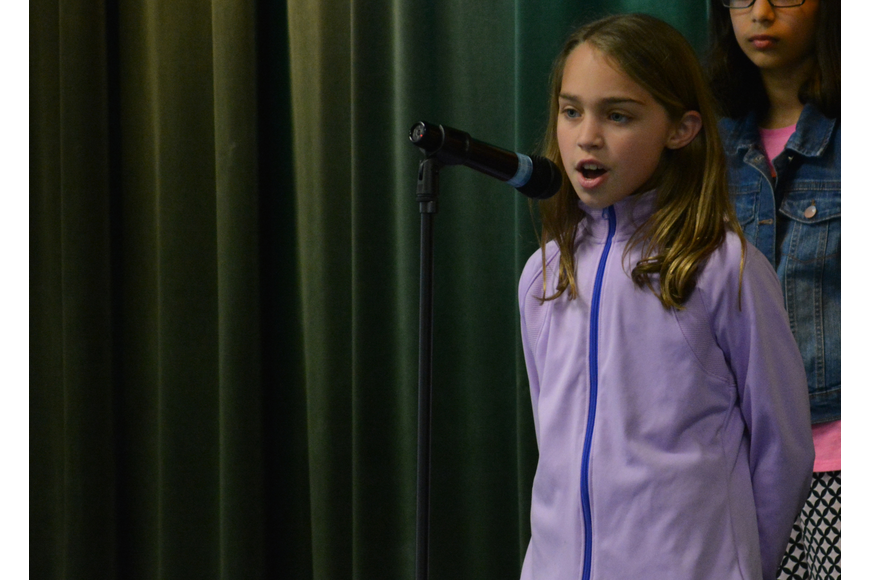 Skyla Bermann performs a solo during Cantissimas Choir performance of
