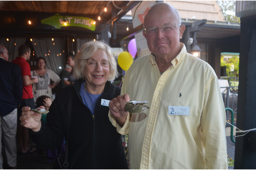 Marcy Kaiser and Warren Kaiser sample some oysters.