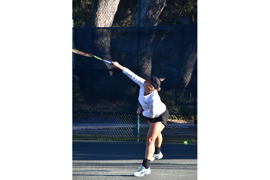 Sandra Weiss serves the ball during the exhibition game.