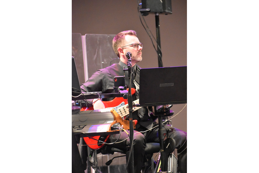 Jay Dodge, music director at WBTT, plays the bass during the event.