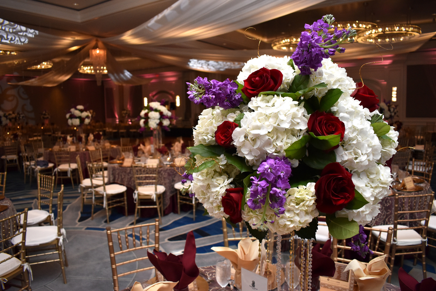 Floral arrangements centered all the tables.
