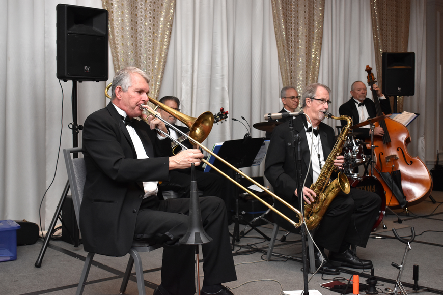 Musicians greeted guests with live music as they entered the ballroom before dinner.