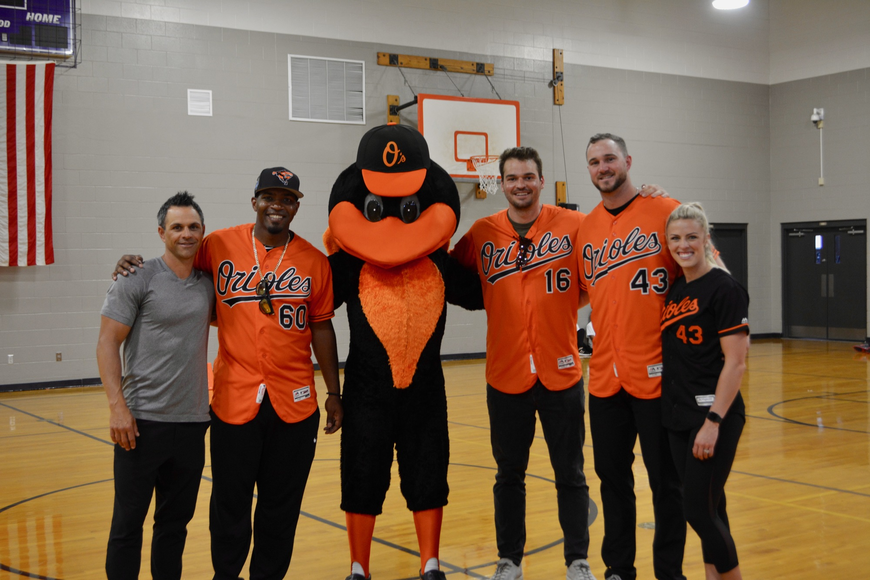 former Orioles second baseman Brian Roberts, Orioles pitcher Mychal Givens, Orioles mascot