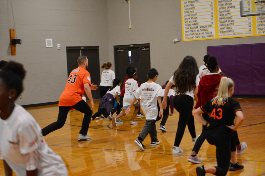 Orioles team members particpated in warm up exercises with the students prior to starting the fitness stations.