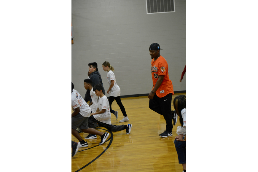 Mychal Givens performed lunges with the team that lost the relay race.