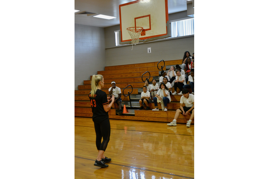 Madison Wright, a personal trainer and registered dietician, talked about healthy eating with Booker Middle students.