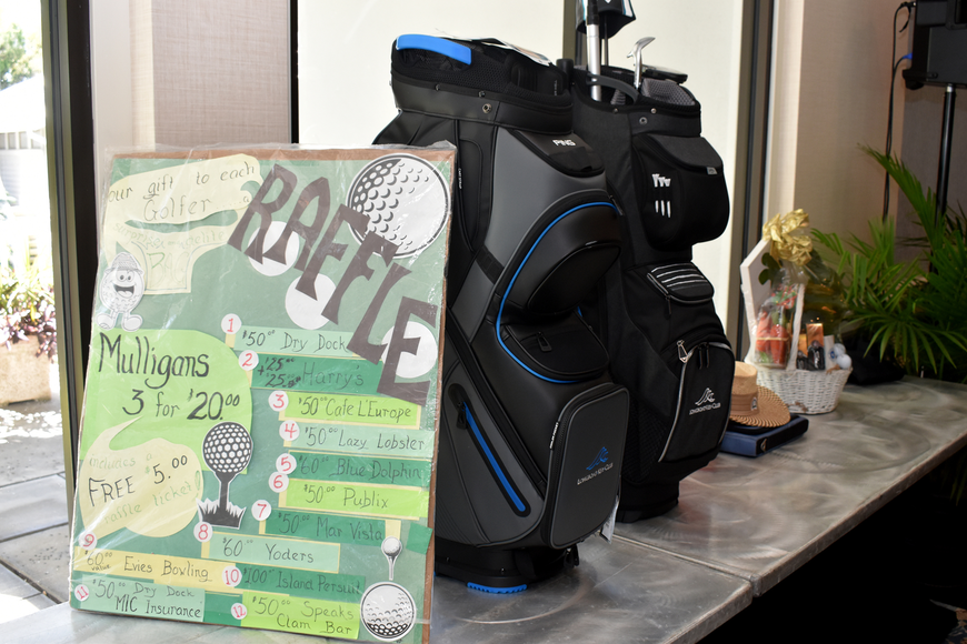 Raffle prizes included golf clubs and gift cards to local restaurants.