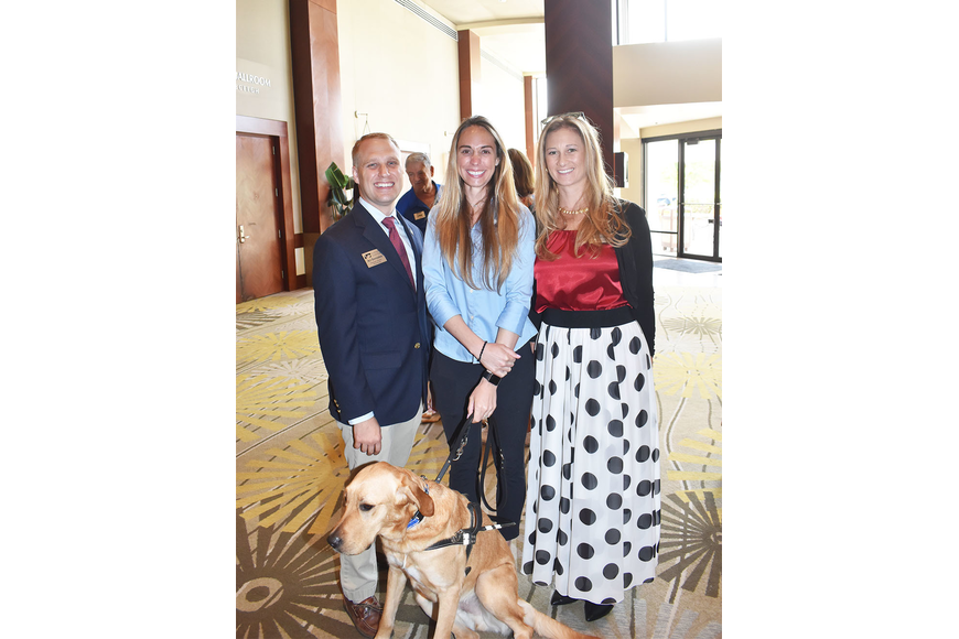 AJ Gonzales, Marisa Gerlach and Jennifer Groff with Astro the guide dog