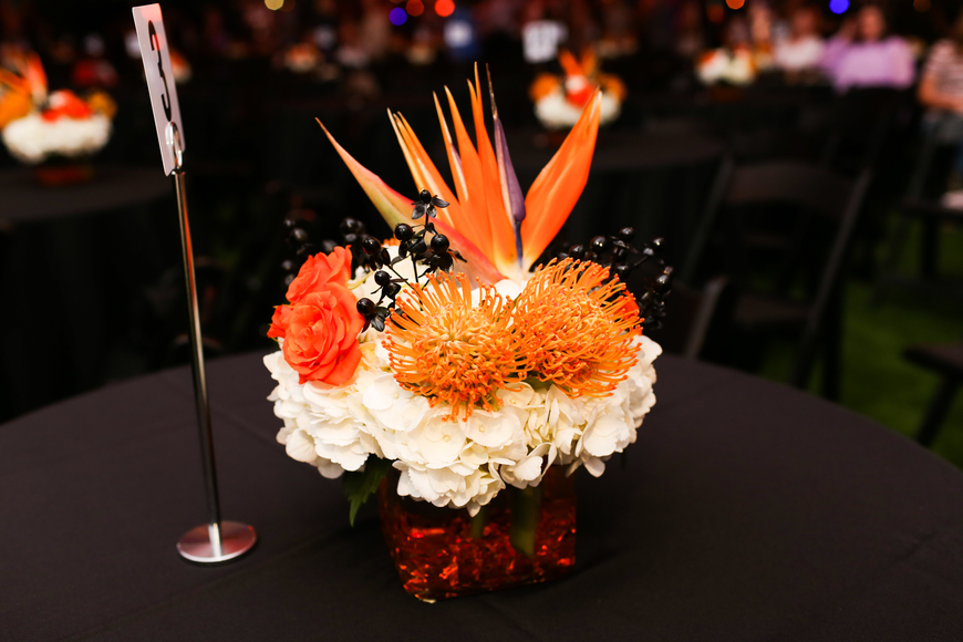 Bright orange florals decorated the tables.