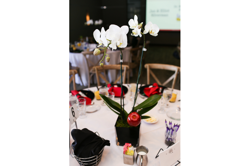 The tables were decorated with orchids and apples.