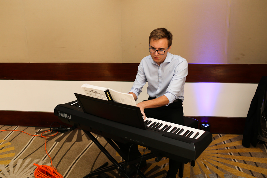 Sam Moss played the piano throughout the party.