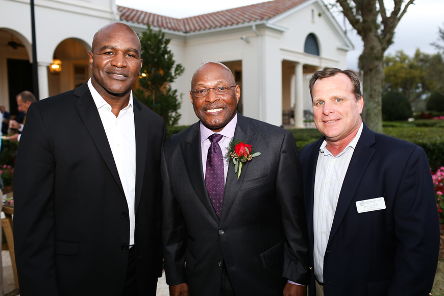 Guest speaker Evander Holyfield, Host Archie Griffin and Boys and Girls Clubs of Sarasota County President Bill Sadlo